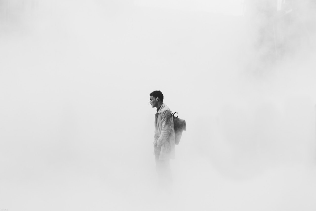 Man Standing in Cloudy Mist