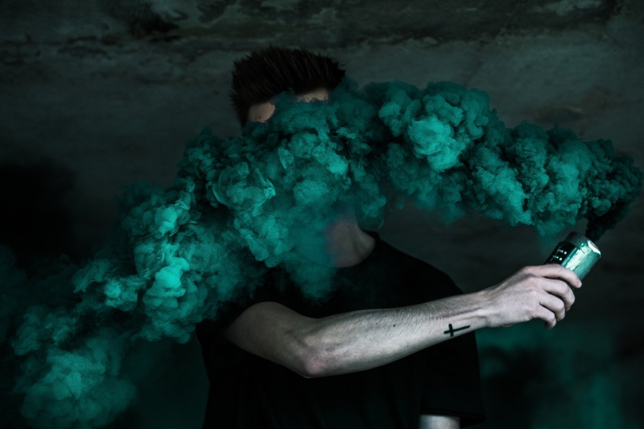 Man with thick smoke covering his face
